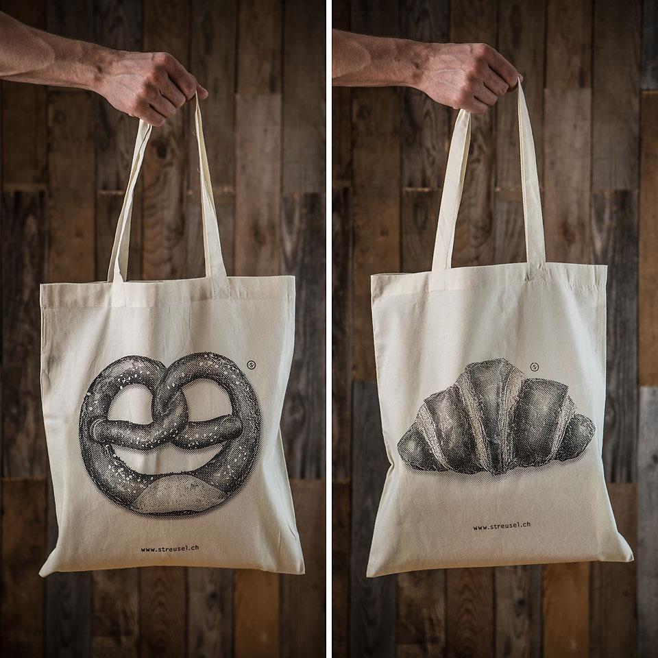 Lässige Stofftaschen «Croissant» und «Brezel» von Streusel. Jetzt bestellen!
